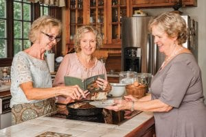 women prepare old family recipe together