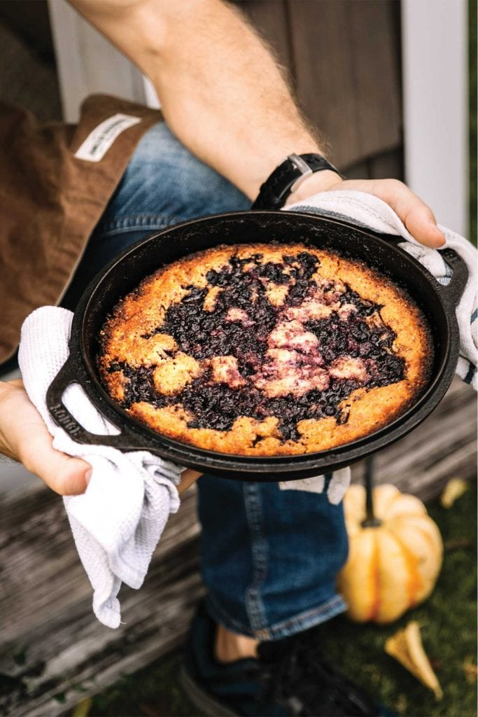 blueberry cornbread cobbler in a cast iron skillet