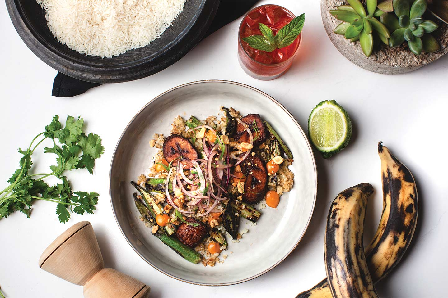 west african shito over charred okra, coconut rice, and sweet plantains