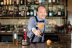 Adam Carter at paloma Bar de tapas making a falltini cocktail