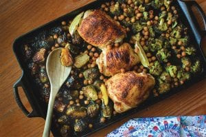 harissa chicken thighs with chickpeas and charred vegetables sheet pan meal
