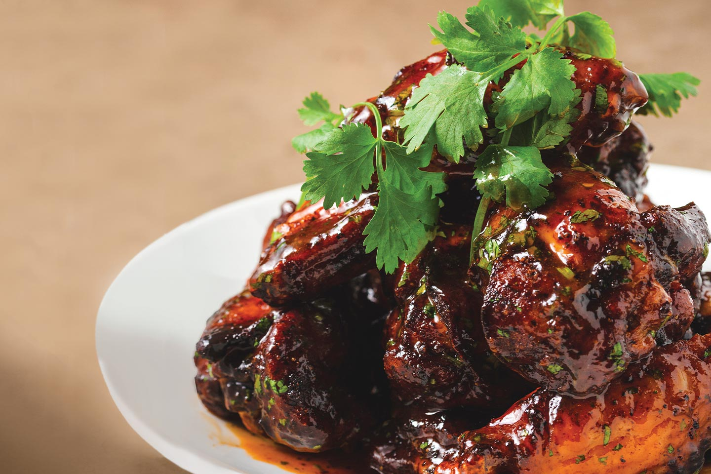 wings from food works with their honey-sriracha wing sauce