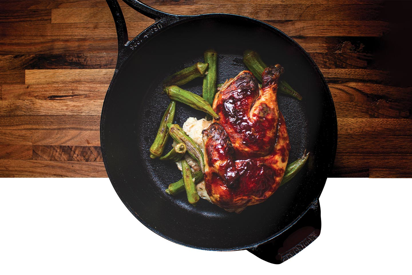 muscadine gastrique on a chicken breast with okra in a cast iron skillet from 1885