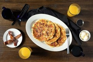 fruity pebbles bacon pancakes from FEED table and tavern with bacon and orange juice