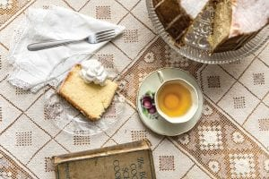 a slice of Christmas golden cake and a cup of tea