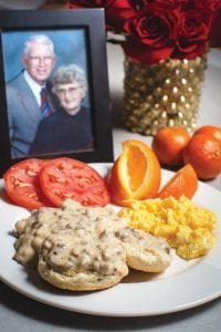 breakfast plate with Blackiston family sausage gravy on biscuit