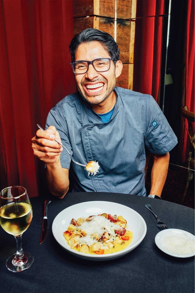 Chef Nehemias Hernandez of Alleia eating gnocchi