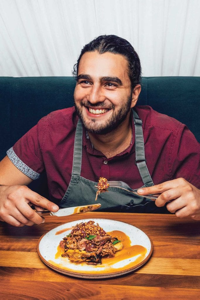Executive Chef Khaled Albanna of Whitebird eating Habanero Glazed Pork