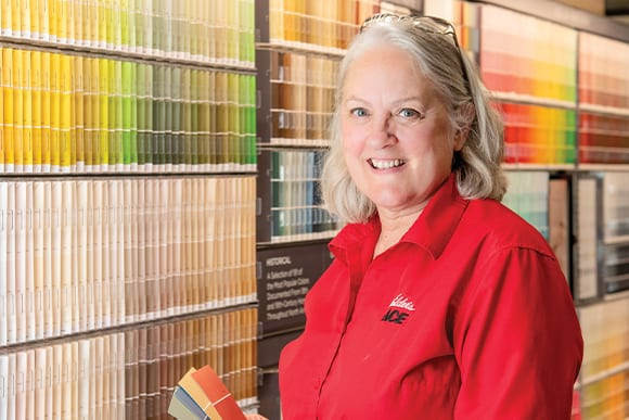 Elder's Ace Hardware associate holding paint swatches