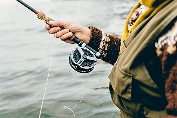 Woman Holding Fly Fishing Rod