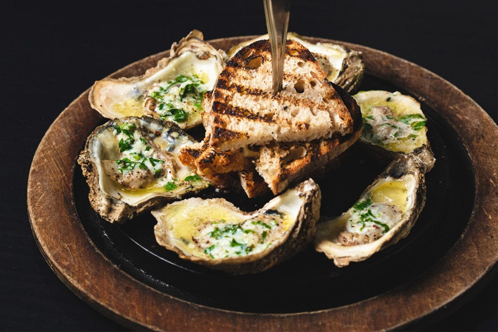 Grilled Chesapeake Oysters and Ciabatta Bread from Boathouse Rotisserie & Raw Bar; Photo by Rich Smith