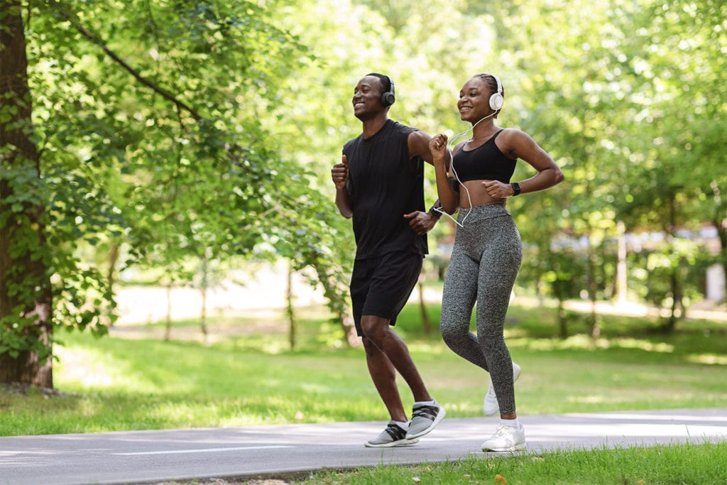 couple running on a paved trail