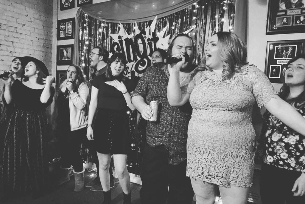 friends singing karaoke at Sing it Or Wing it in Chattanooga