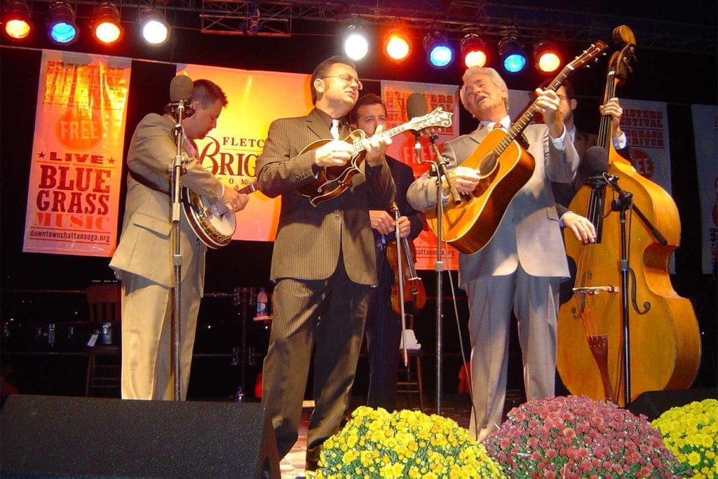 performers on stage at the 3Sisters Bluegrass Festival