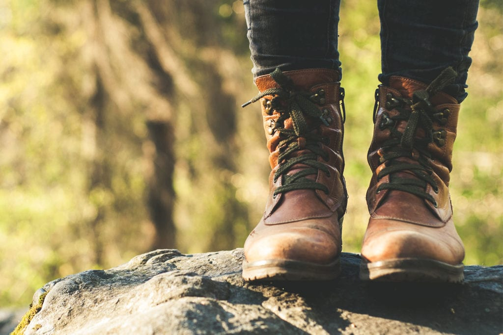 Woman in Hiking Boots standing on rock