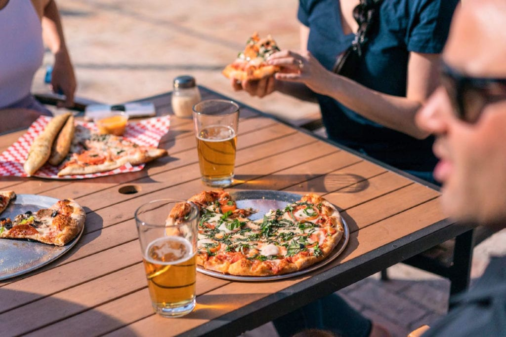 people eating outdoors at Goodfella's Pizza