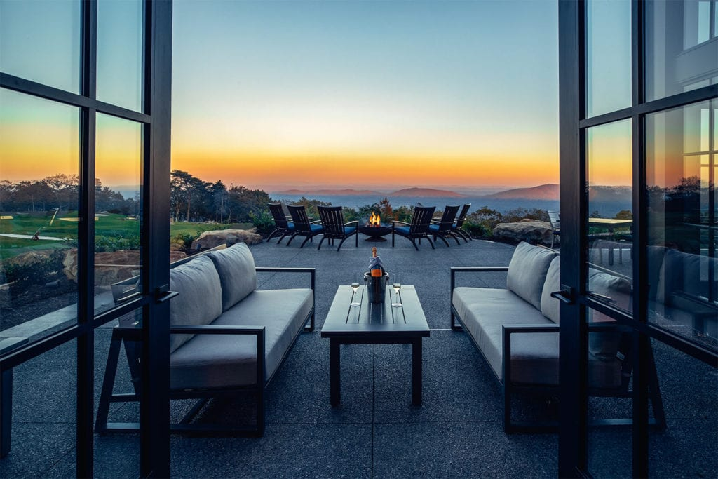 outdoor seating area with beautiful views of the sunset at McLemore; Photo by Lanewood Studio