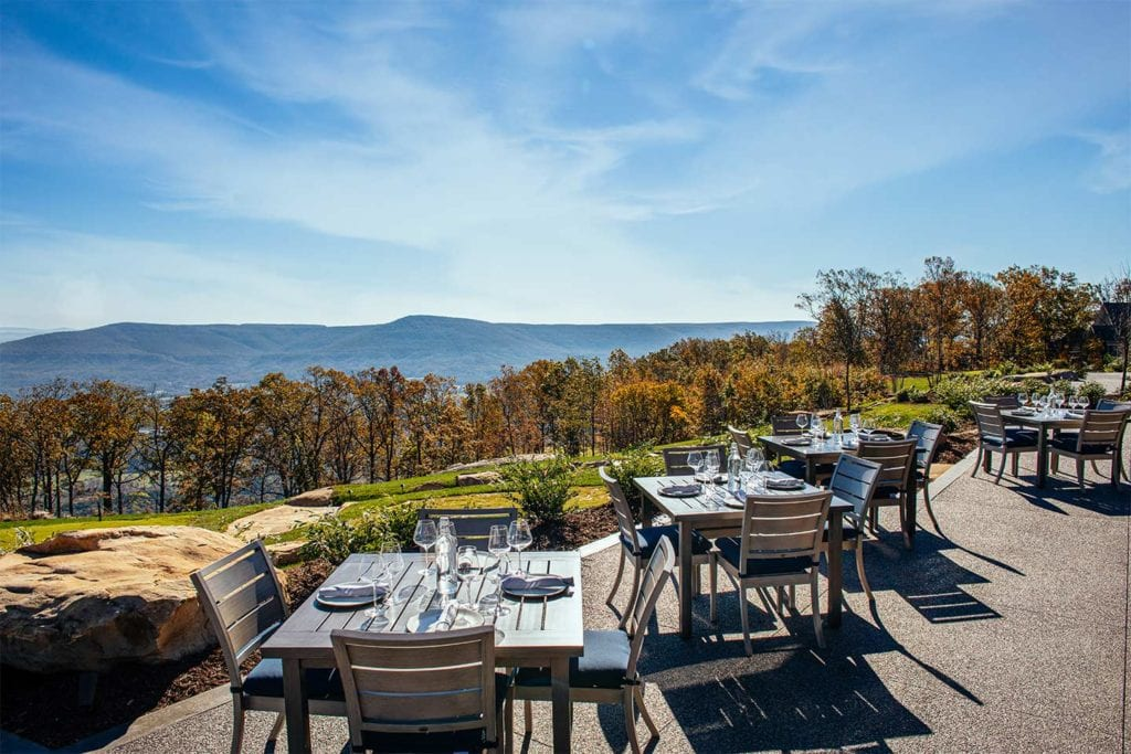 Outdoor dining area with a beautiful view at the Creag at McLemore; Photo by Lanewood Studio