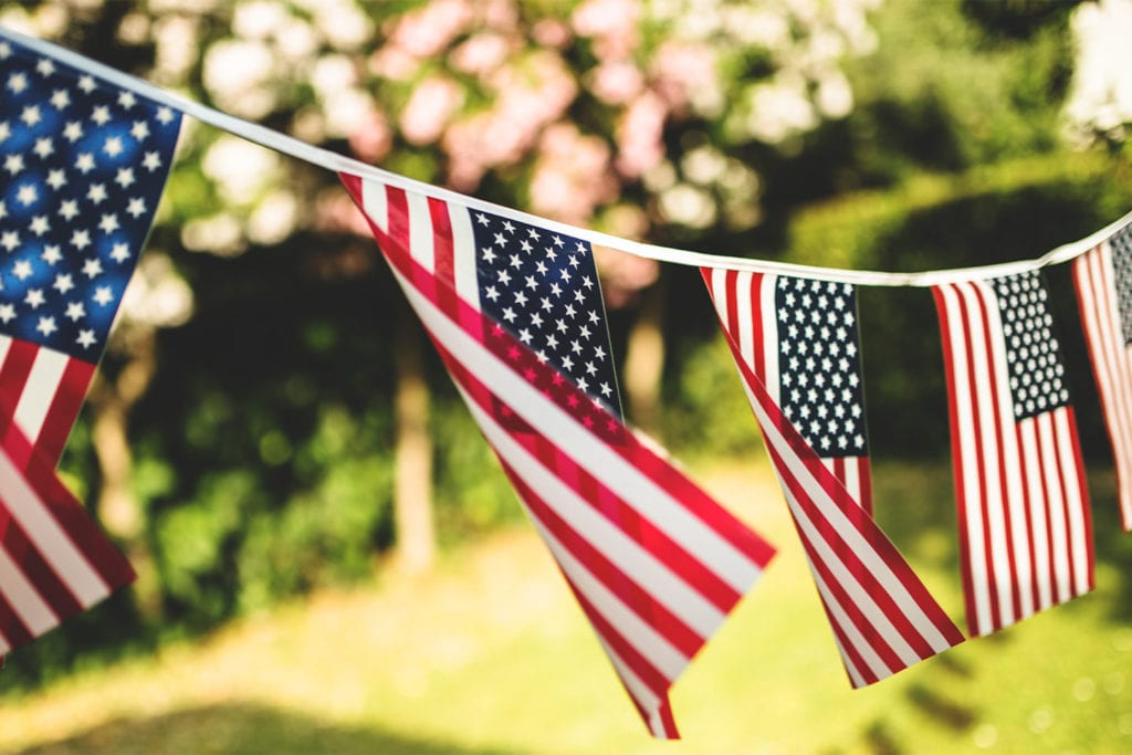 American flag banner waving in the wind for the fourth of july