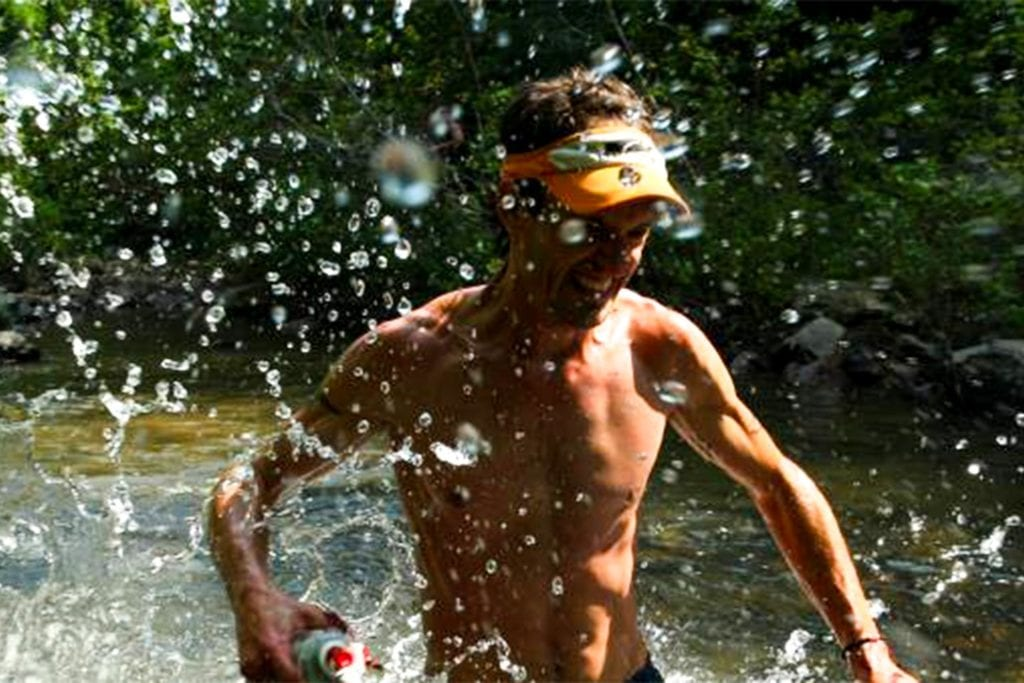 runner going through a creek in the Chattanooga Mountain Stage Race