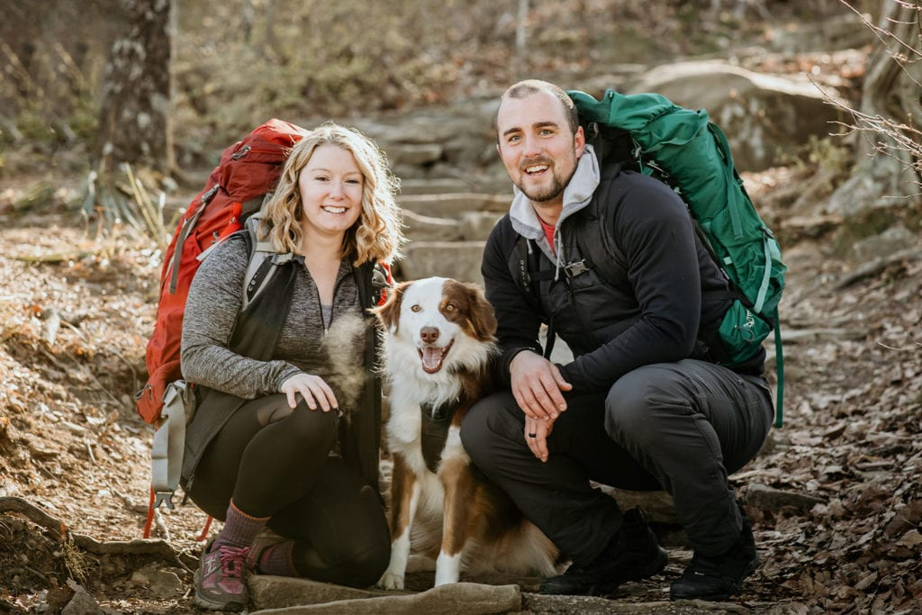 couple hiking with their dog; Photo by Sarah Unger