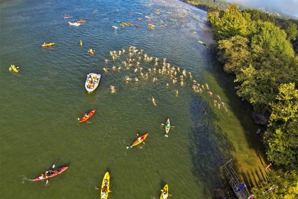 Swimmers and kayakers in Suck Creek for Swim the Suck