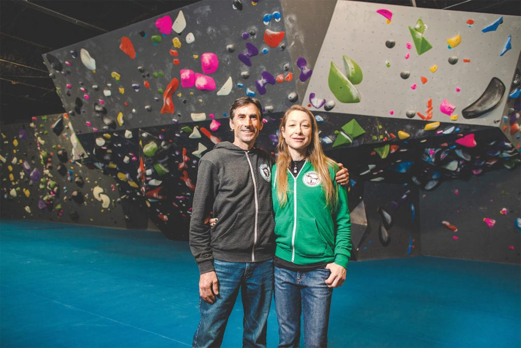 Founders of Synergy Climbing & Ninja standing in their climbing gym