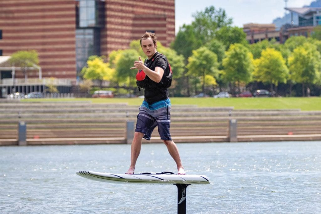 Man riding an e-foil from Adventure Sports Innovation in the Tennessee River