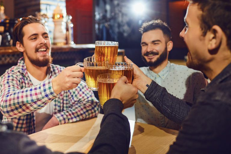 guys hanging out at a bar
